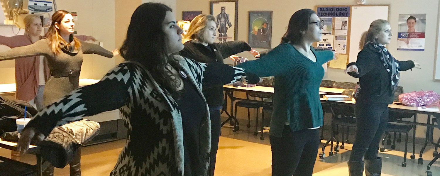 """First year radiology students take part in """"Mindful Yoga"""" prior to starting radiographic positioning lab on campus."""