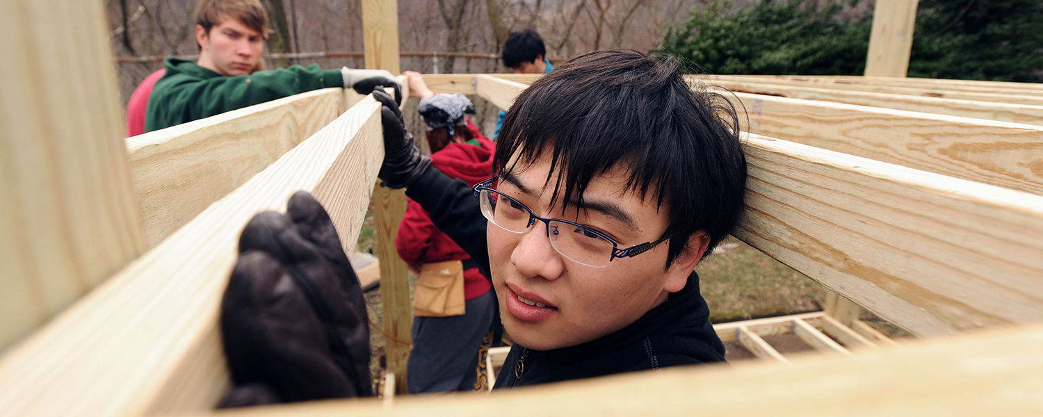 Kent State student volunteers work on the construction and repair of playground equipment in East Liverpool during a Kent State alternative spring break trip.