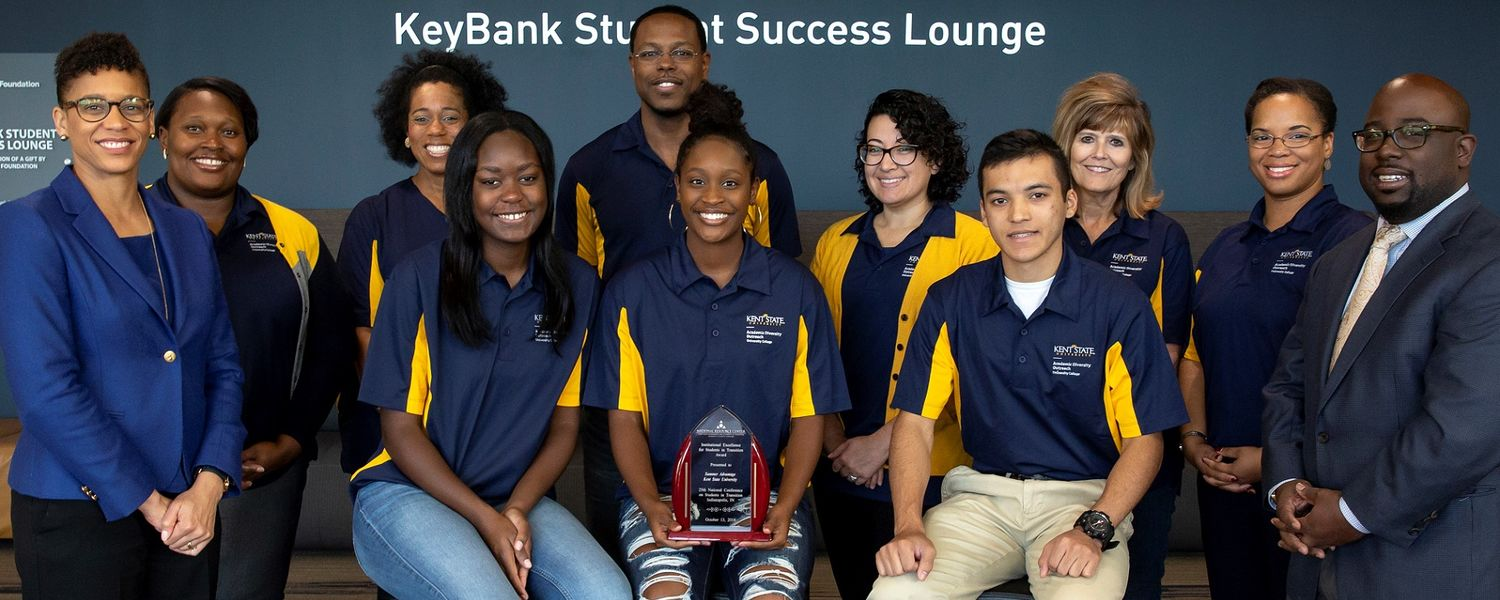 University College Dean Eboni Pringle (far left) smiles with her staff and Summer Advantage students.