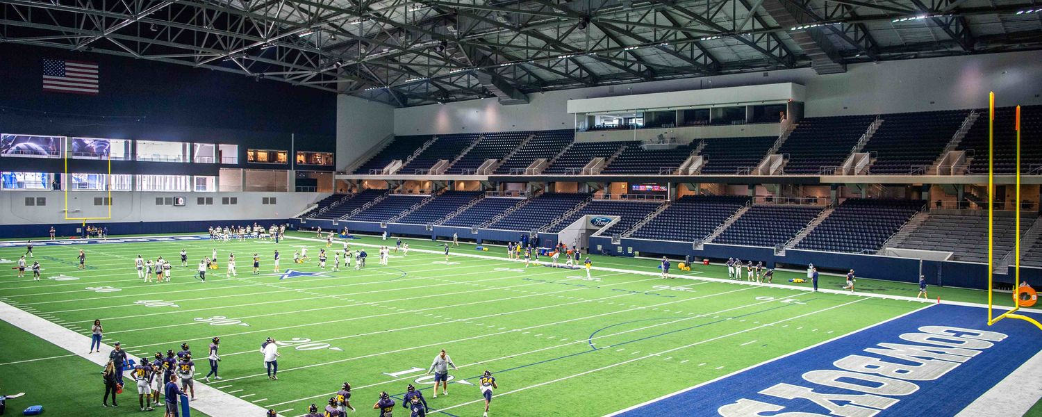 Cowboy Up! Golden Flashes work out at the practice facility of the Dallas Cowboys to prepare for Frisco Bowl.