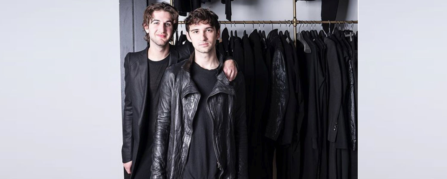 """Alexandre Marr (left) and Dominic Iudiciani (right) pictured in 2018 with pieces from their KSU Museum exhibit collection """"Beyond the Suit."""" (Photo by Dominic Iudiciani)"""
