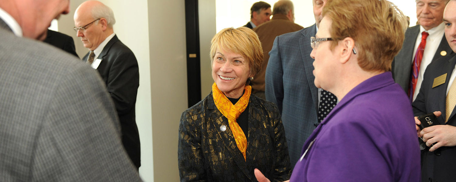 Kent State President Beverly Warren talks with attendees of the grand opening celebration for the new Aeronautics and Technology Building.