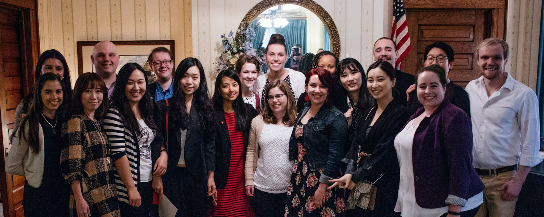 all graduate student award recipients pose together