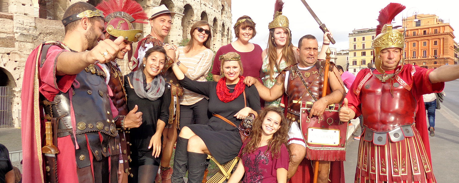 """On a day trip to Rome, a group of Kent State students hasfun with some """"Roman Soldiers"""" outside of the Coliseum. (Photo provided by Kari Carnes)"""