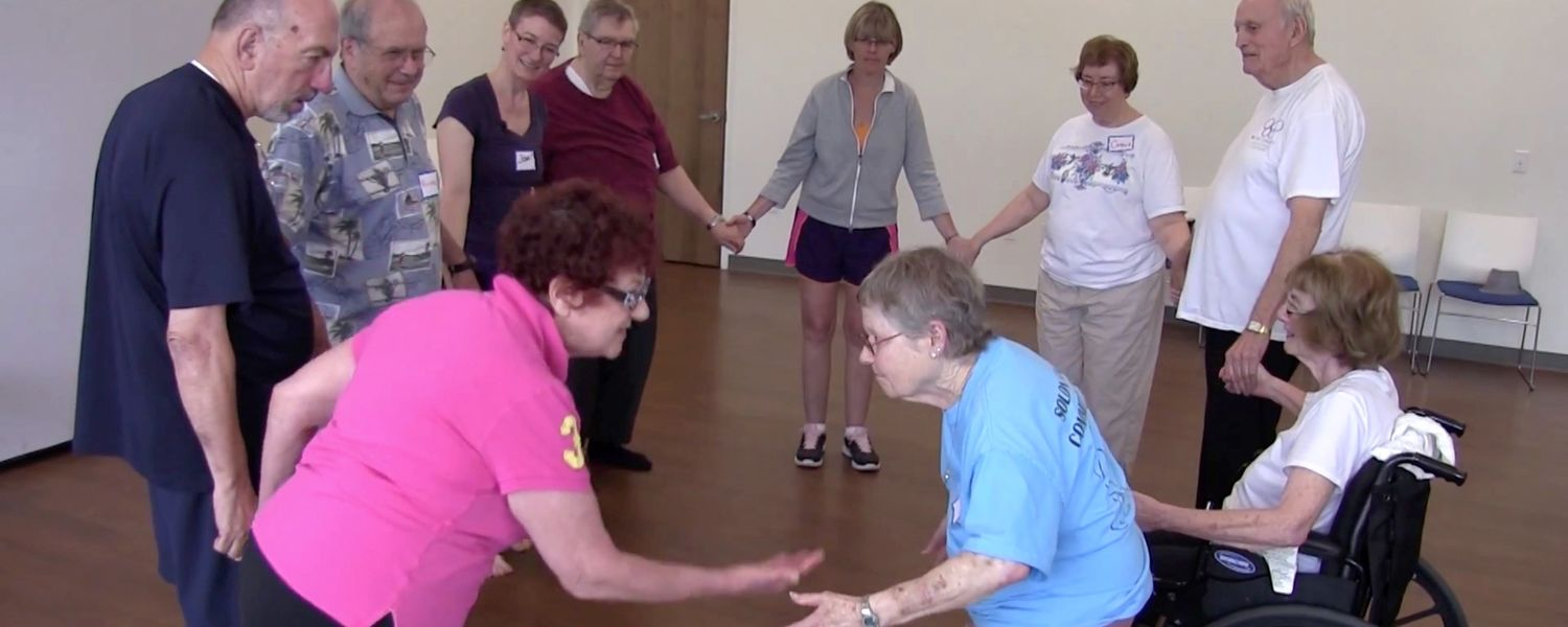 Associate Professor of Dance Joan Meggitt teachers a class for Parkinson's disease sufferers.