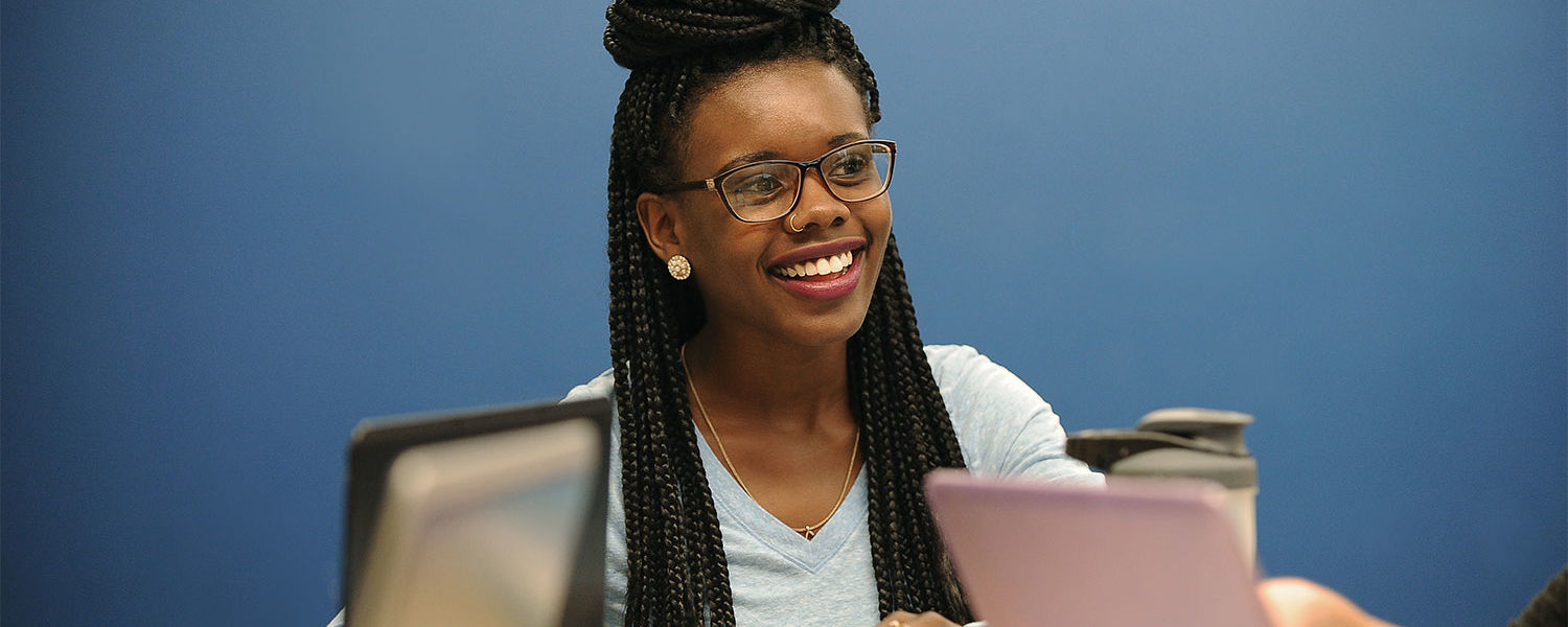 A Kent State student smiles during her public health class.