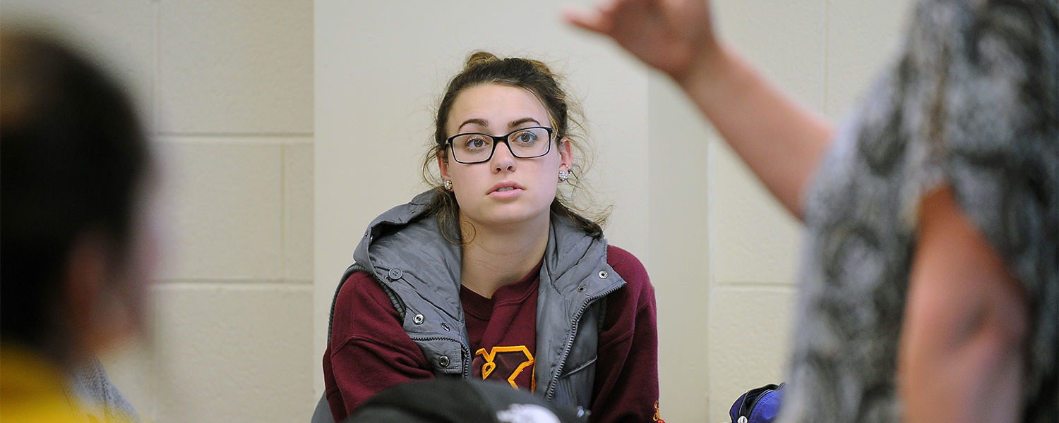 A Kent State student listens while her instructor from the College of Public Health gives a lecture to the class.