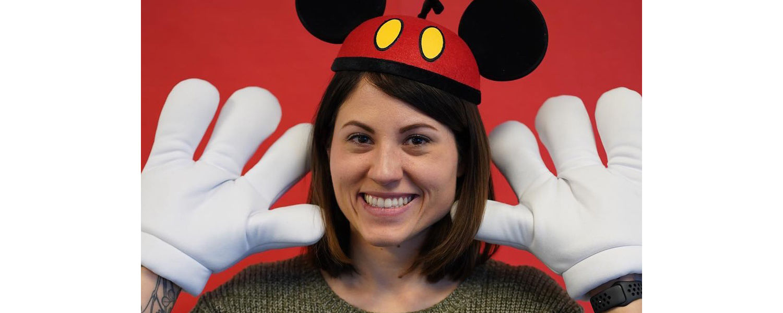Jobes UXD Disney employee wearing mickey ears and hands