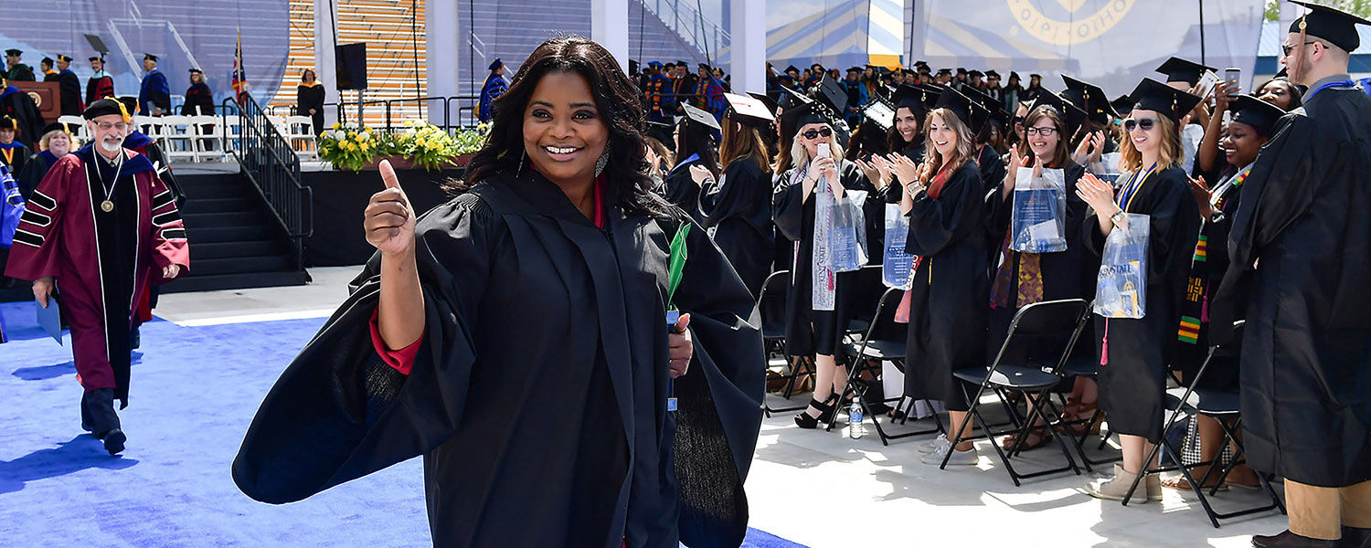 Commencement speaker Octavia Spencer gives a thumbs up to the Kent State students who cheer for her following her address during the One University Commencement Ceremony.