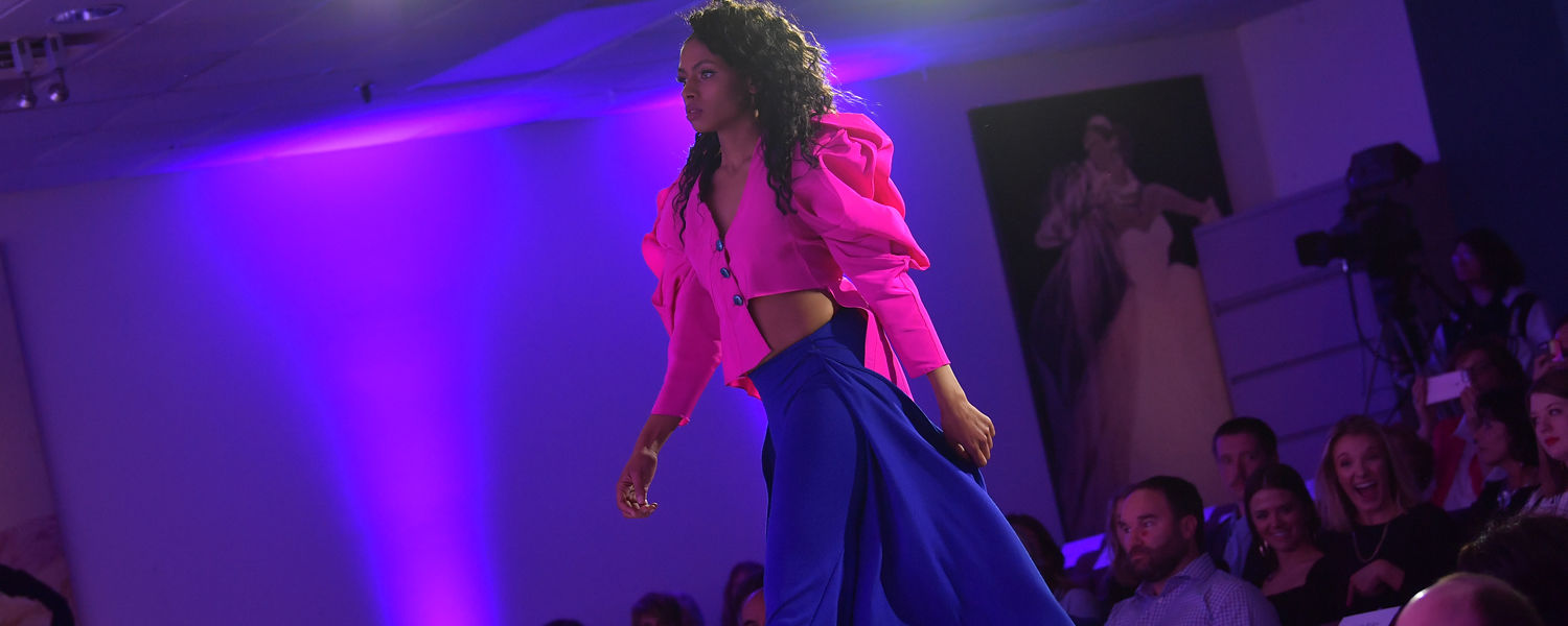 Student walking the runway during 2019 Annual Fashion Show.