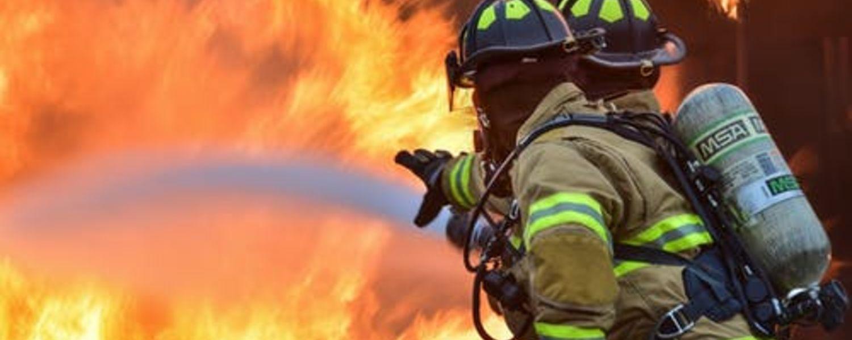 Firefighters battle a blaze.