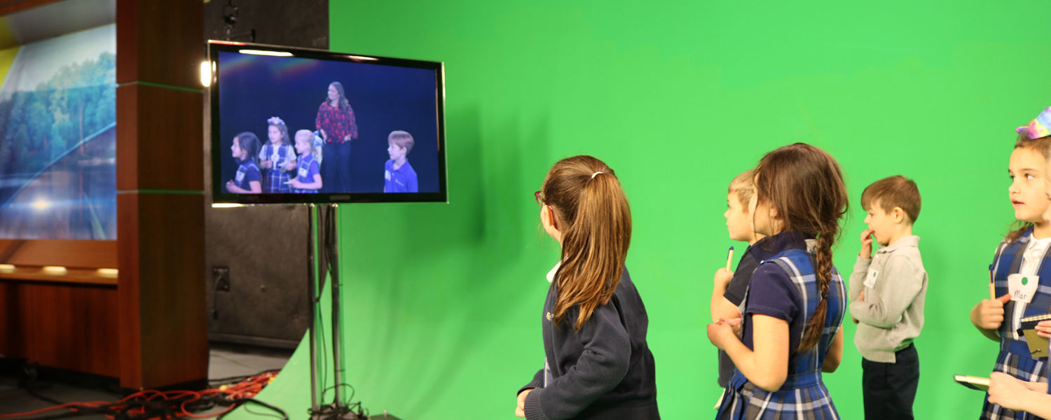 St. Barnabas first graders in front of green screen
