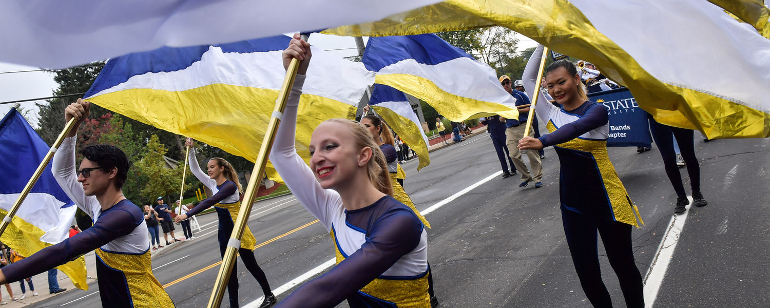 A member of the marching band makes her way down Main Street during the Homecoming Parade.