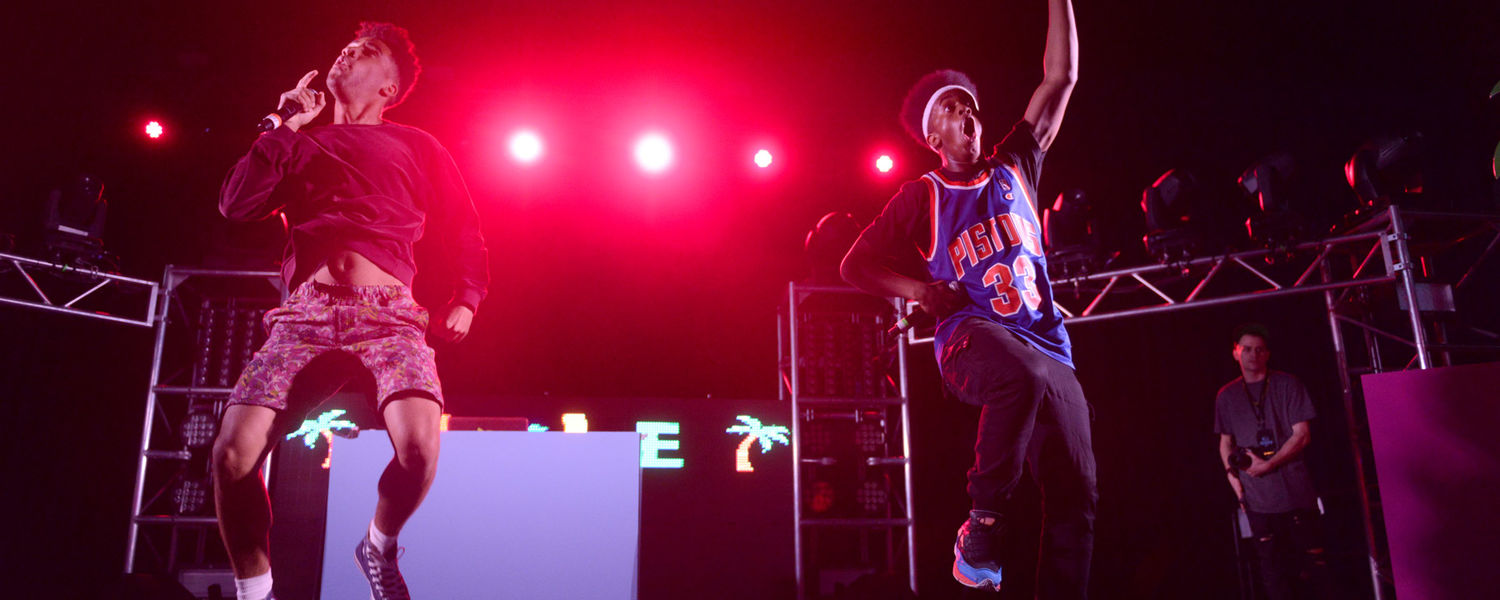 Rapper Kyle (left), also known as Super Duper Kyle, and his disc jockey jump on stage at Kent State's FlashFest 2015.