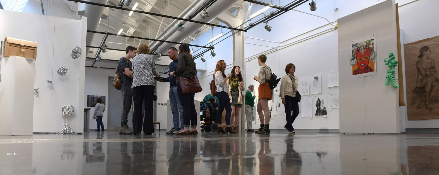 Visitors tour one of the galleries in Kent State's Center for the Visual Arts during the building's grand opening.