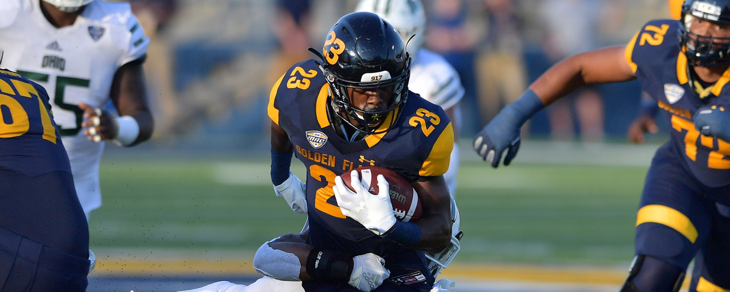 Kent State wide receiver Isaiah McKoy gains some yards during the second half of the Homecoming football game.