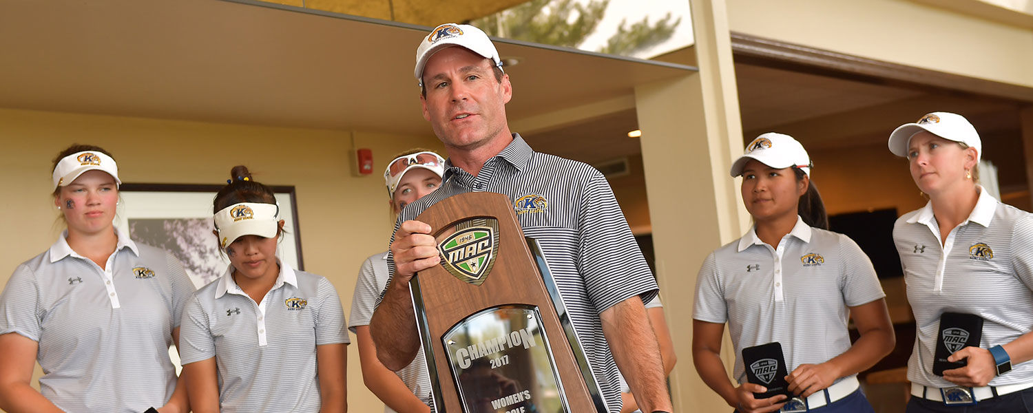 Greg Robertson, head coach of Kent State women's golf, holds the 2017 MAC Women's Golf Championship Trophy. Robertson was named MAC Coach of the Year.