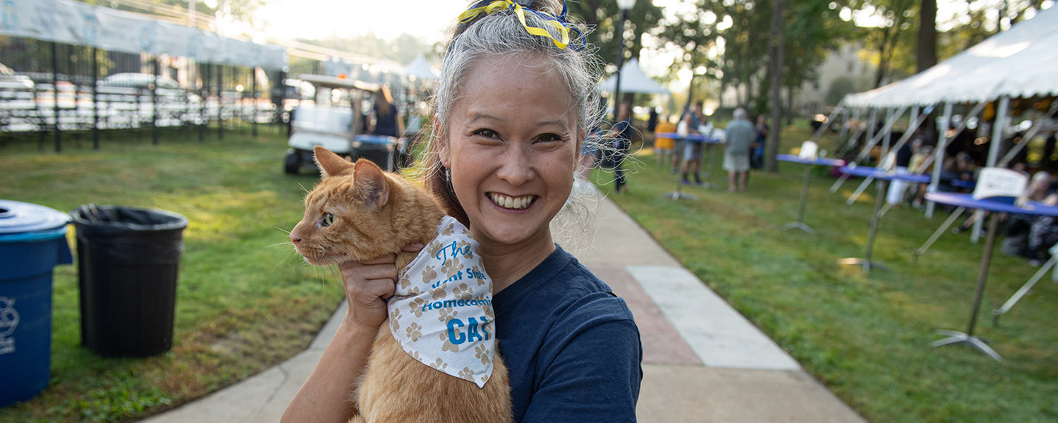 "A Kent State professor holds the ""Homecoming cat"" she has brought to Kent State's Homecoming for five years."