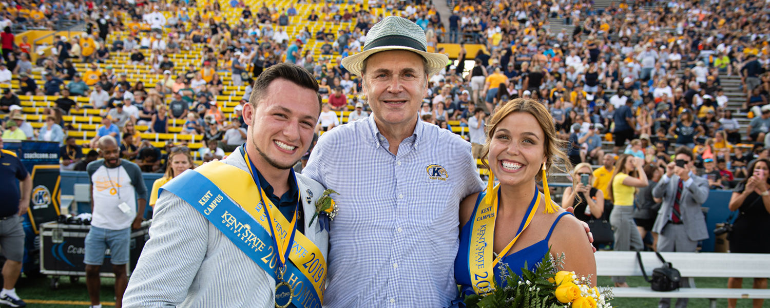 Kent State President Todd Diacon (center) poses with the university's 2019 Homecoming Royalty Robby Speaks and Haylee Hoyt.