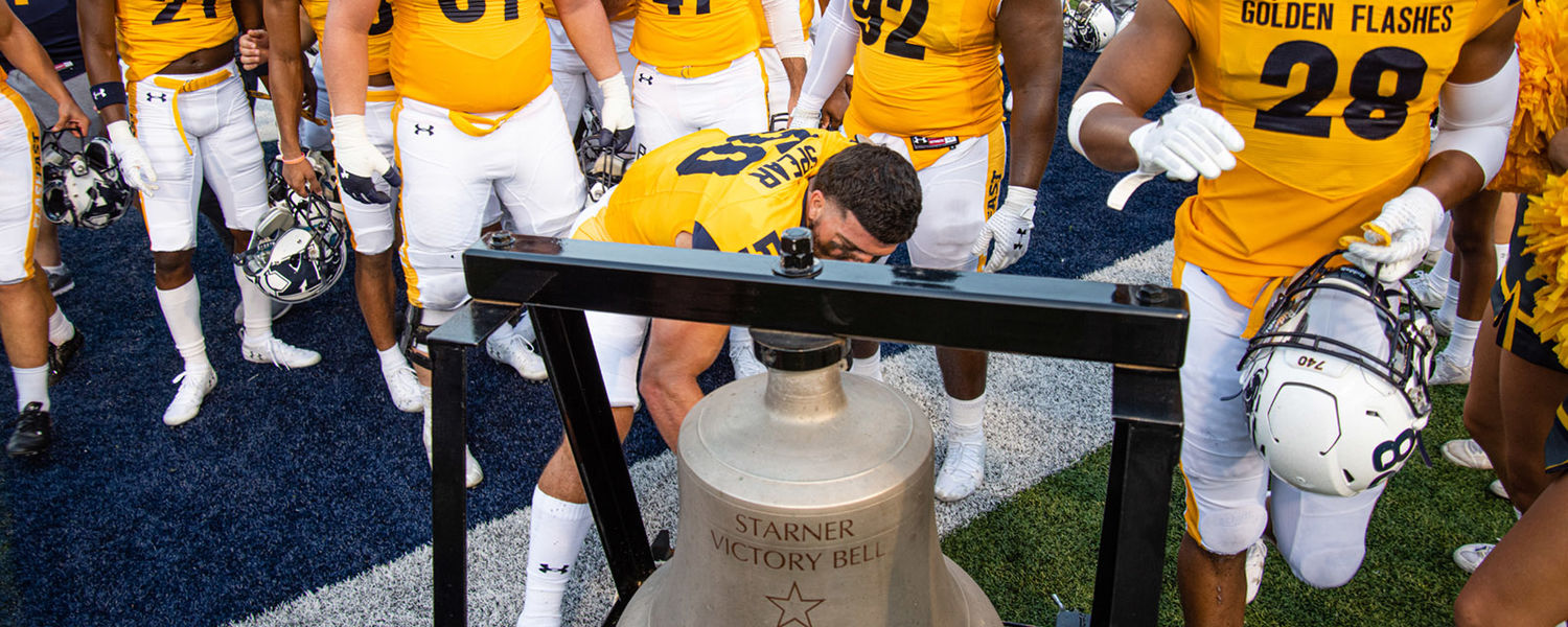 The Kent State Golden Flashes ring the Starner Victory Bell after winning the 2019 Homecoming Game 62-20 over the Bowling Green State University Falcons.