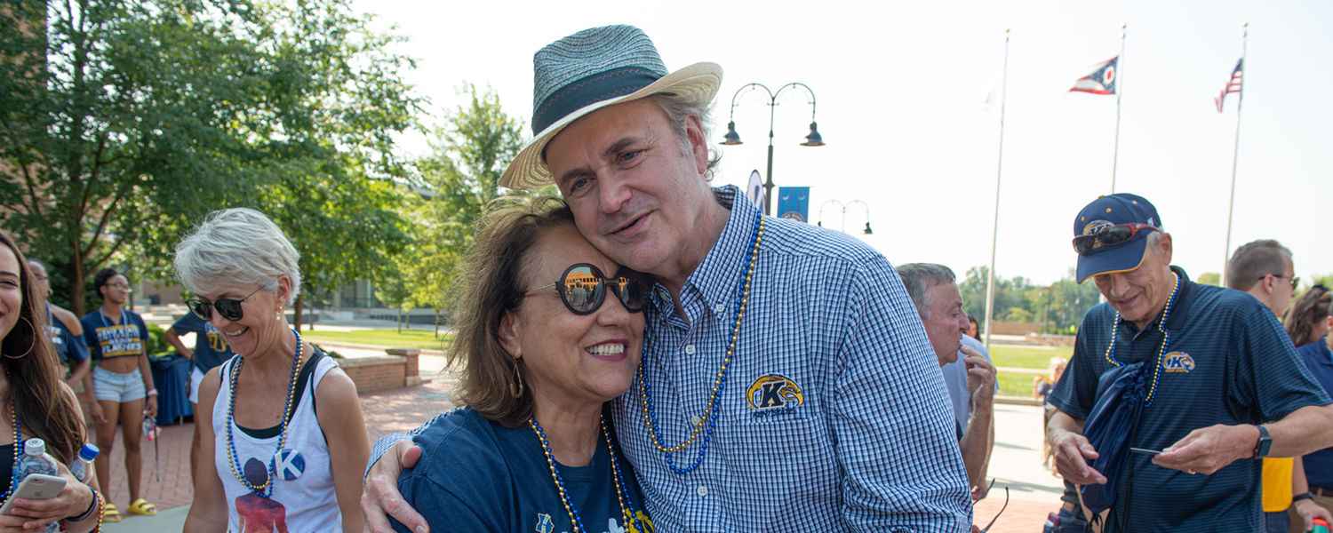 Kent State President Todd Diacon and his wife, Moema Furtado, embrace during the Kiss on the K event during Kent State's 2019 Homecoming.