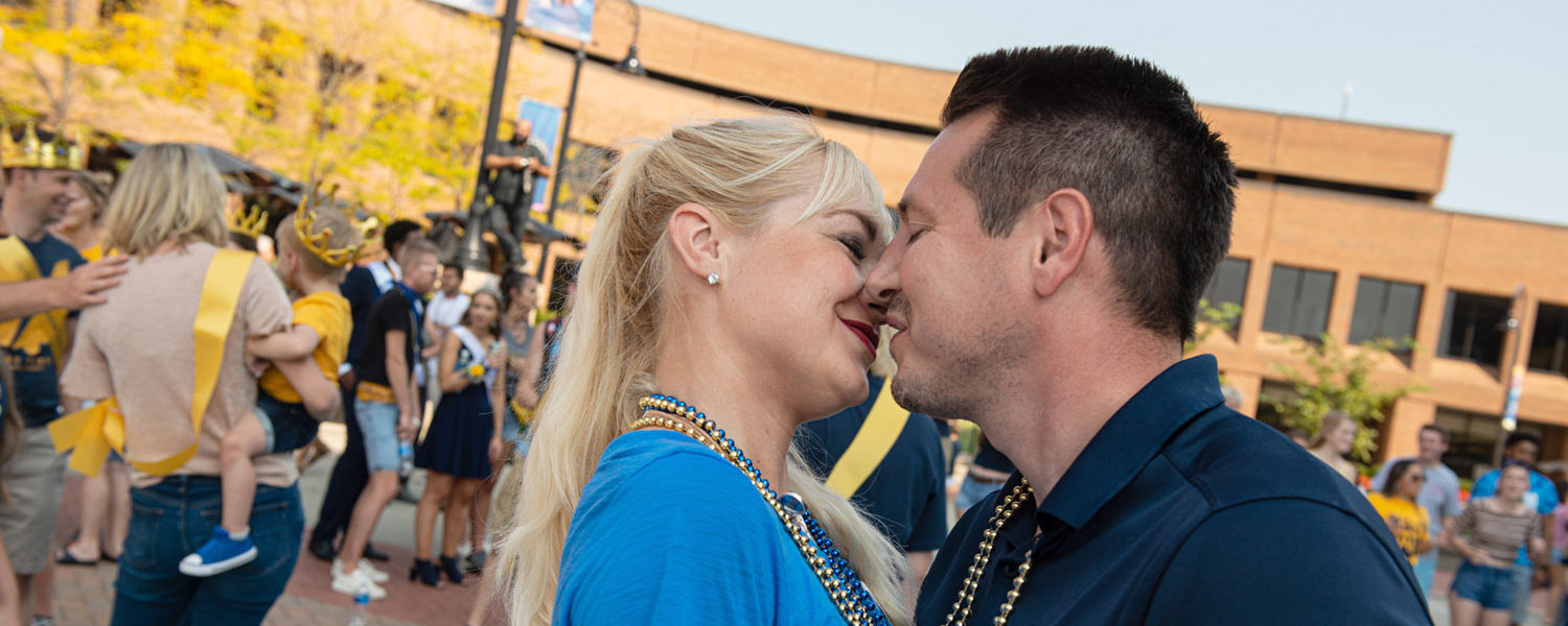 A couple embraces each other during the Kiss on the K event.
