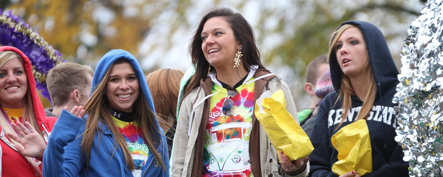Kent State students from the College of Education, Health and Human Services ride on a float in the university's Homecoming parade.