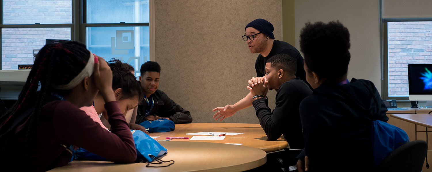 Students gathered around a table