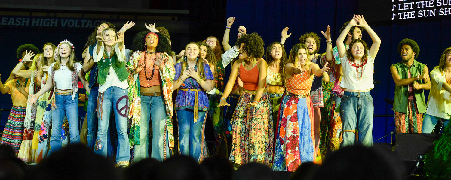 """Students from Kent State's School of Theatre and Dance perform songs from """"Hair"""" during the presidential inauguration of Todd Diacon."""