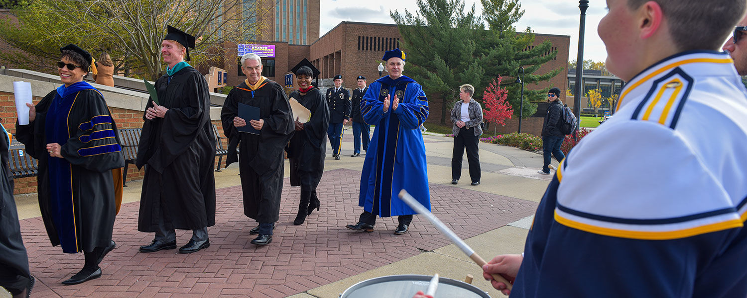 Members of the Marching Golden Flashes serenade the stage party as they enter the Memorial Athletic and Convocation Center.