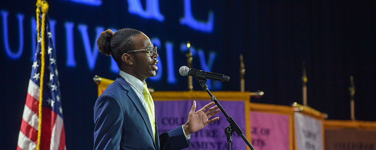 """Kent State student Brandon Bell sings """"America the Beautiful"""" to open the inauguration ceremony of Kent State's 13th president, Todd Diacon."""