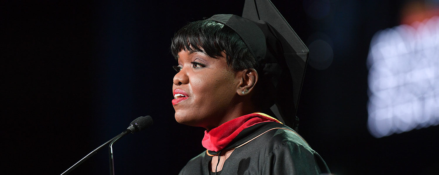 Kent State alumna Danielle Wiggins welcomes attendees of the presidential inauguration.