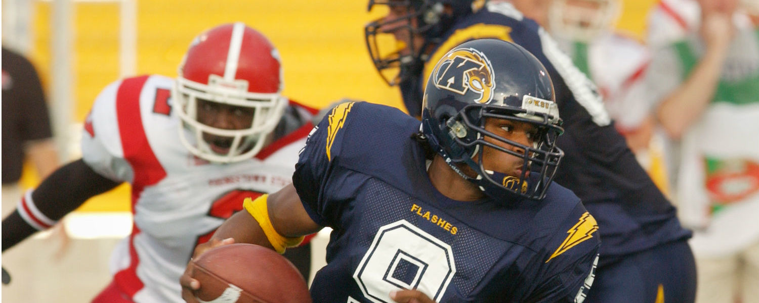 Josh Cribbs keeps the ball on an end run against Youngtown State University during a 2003 home opener at Dix Stadium. The former Kent State quarterback and NFL star returns to his alma mater to serve as the 2016 Homecoming Parade Grand Marshal.