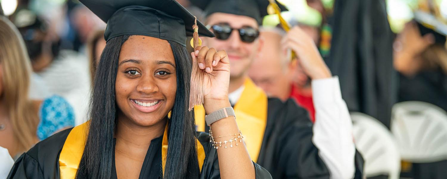 New Kent State graduates turn their tassels during their commencement ceremony.