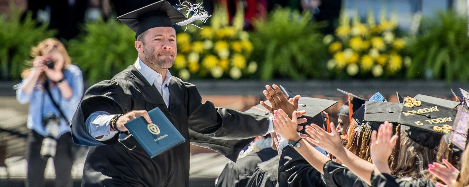 3c757222bfa5a3 New England Patriots wide receiver Julian Edelman is congratulated by  fellow Kent State graduates at the