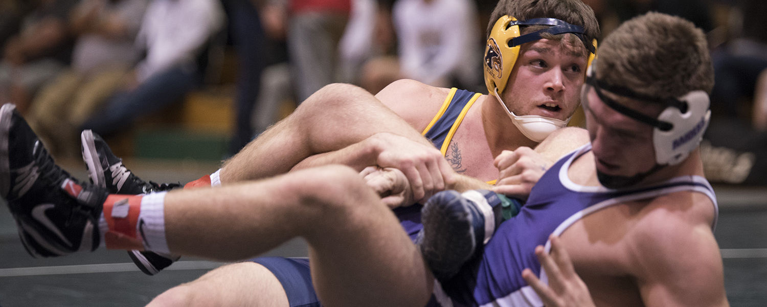 Kent State wrestler, Lane Hinkle, competing on the mat for the Flashes