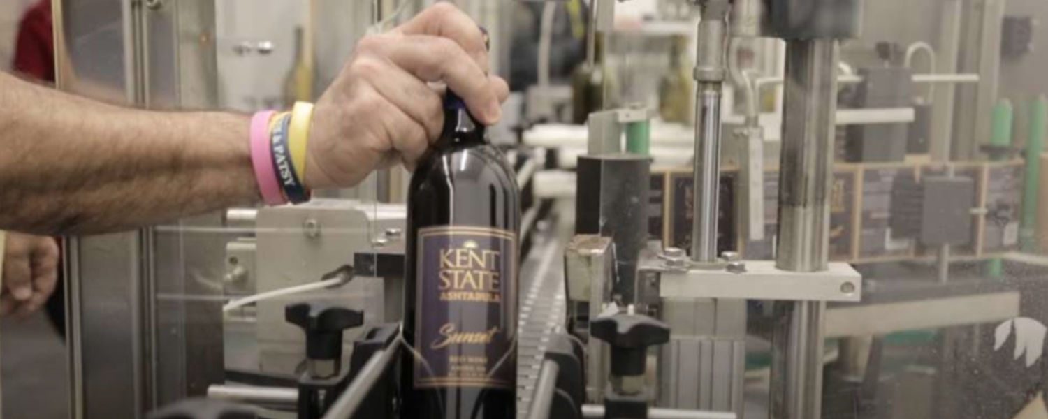A bottle of Kent State Ashtabula wine is pulled off the bottling line