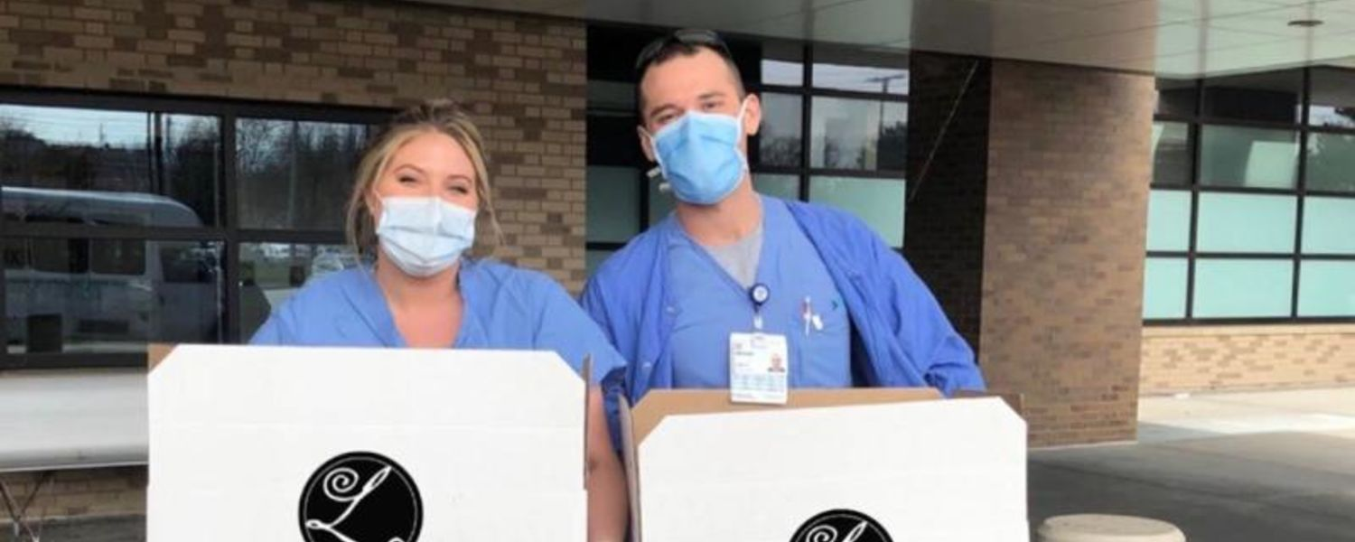 Emergency room workers from Cleveland Clinic's Main Campus receive meals from Lago East Bank provided with donations from a Kent State alumnus and others.