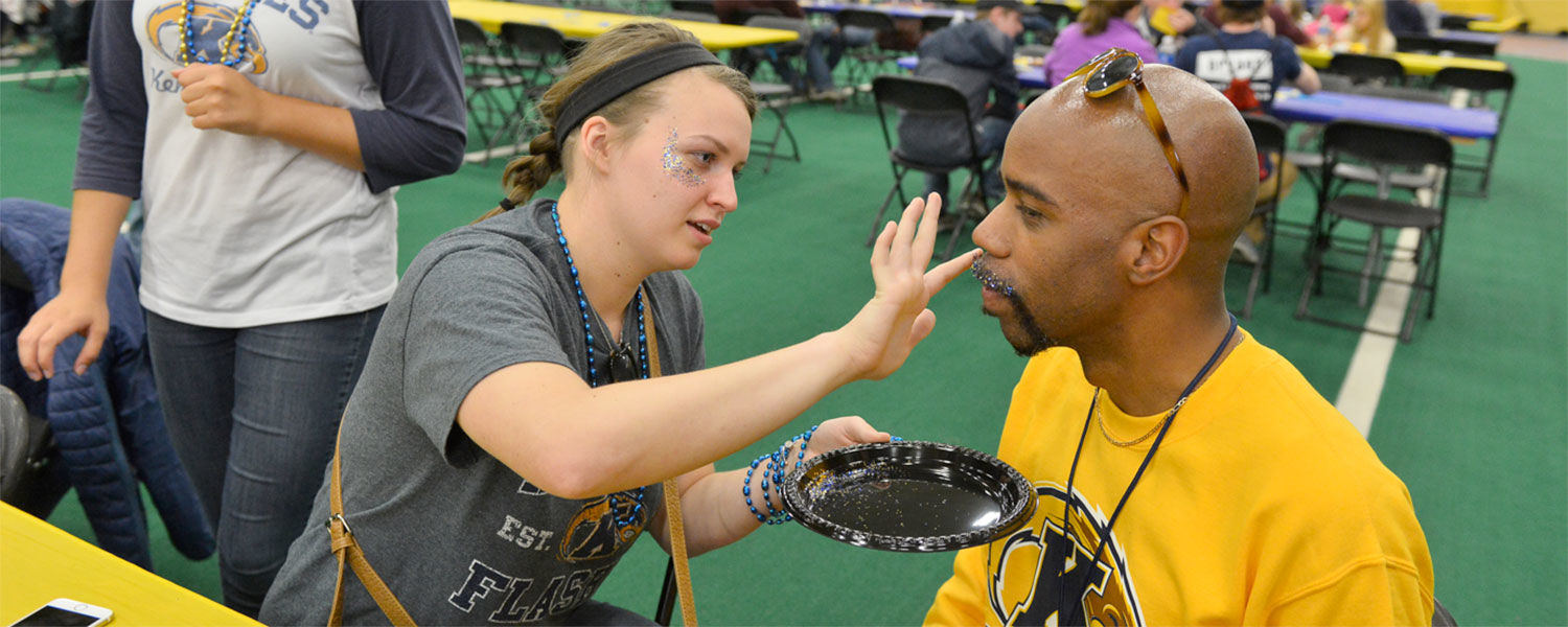 Dr. Lamar Hylton dons the Golden Flash colors along with a little glitter for added style thanks to a student.