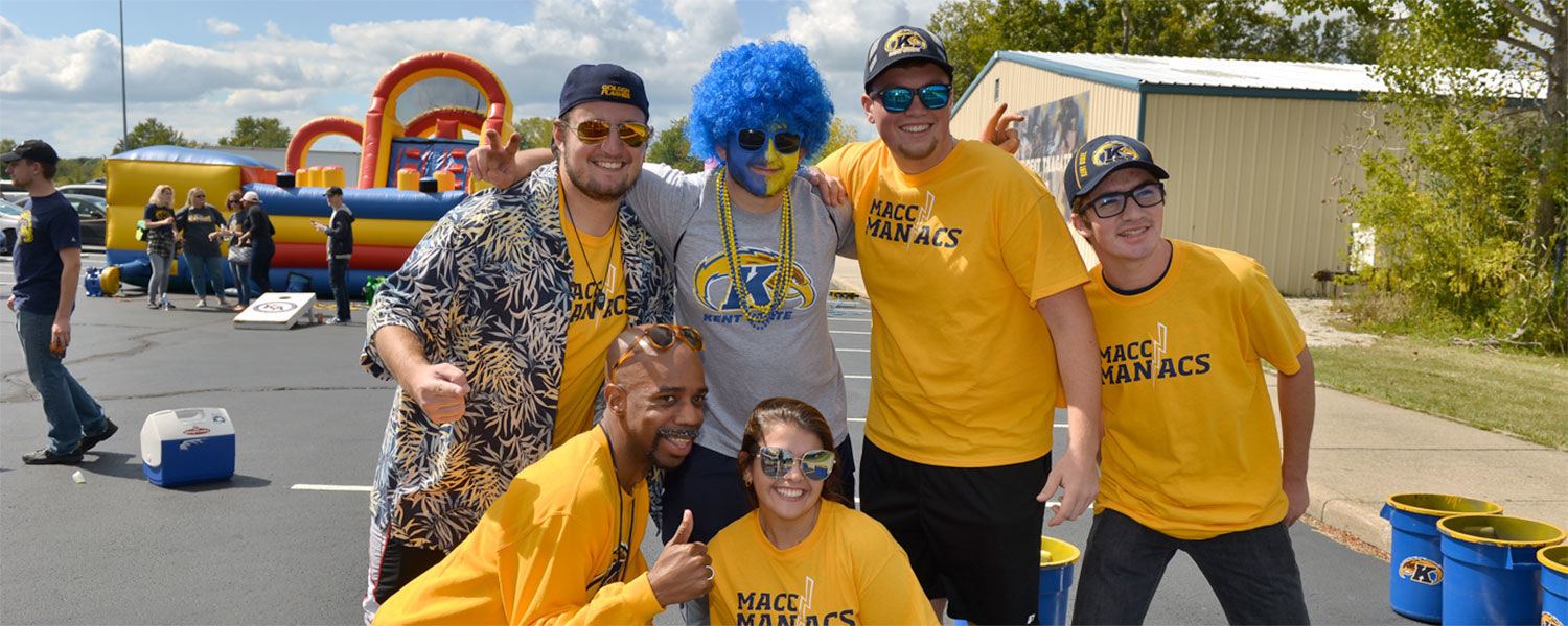 Dr. Lamar Hylton enjoys bonding with students before a Kent State football game.