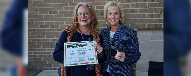 Senior Lecturer Lorene Martin (left) holds her DAISY Award certificate next to Assoc. Dean Tracey Motter (right)