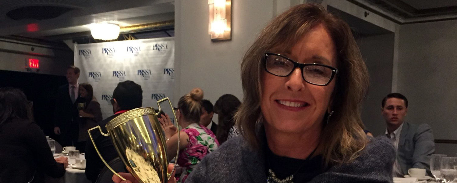 Associate Professor Michele Ewing with her Teahan Faculty Advisor Award at PRSSA National Conference.