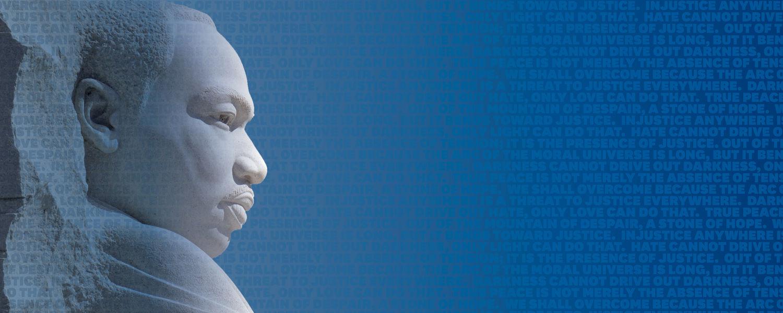 MLK Jr Statue on a blue background