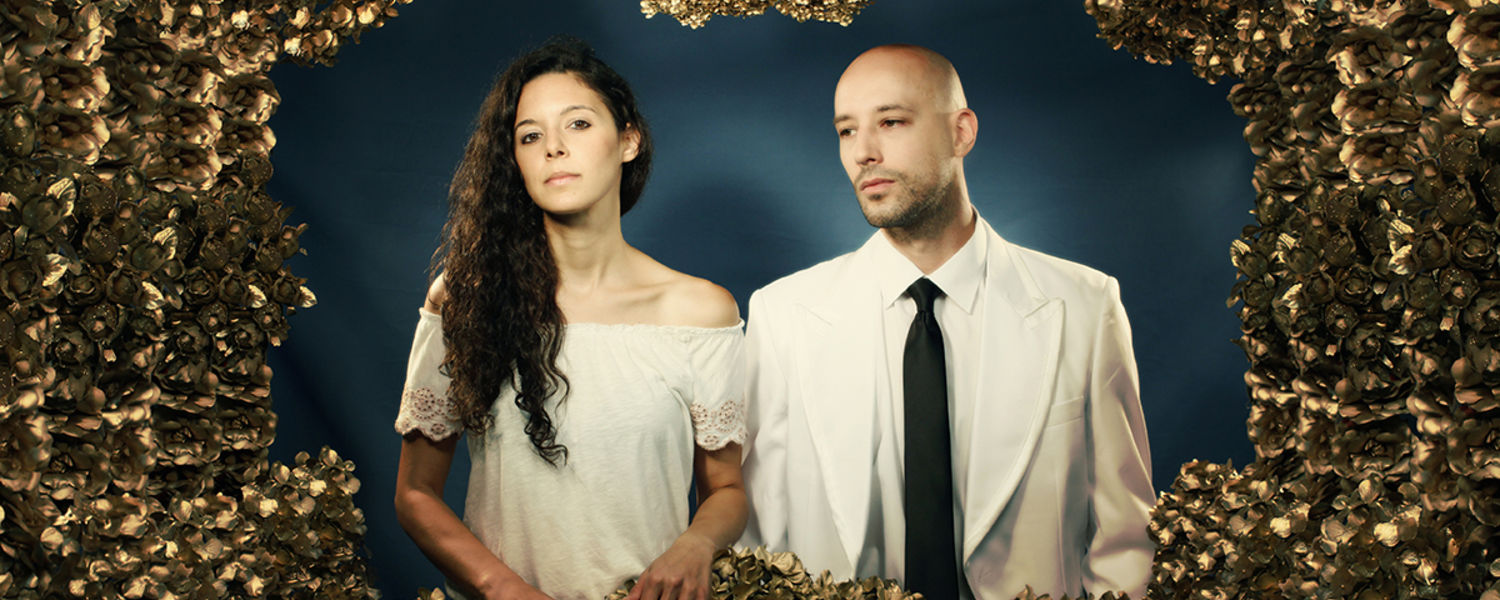 Members of the band mr. Gnome, including art eduction alumna Nicole Barille; image of a woman and man standing in a frame of gold leaves