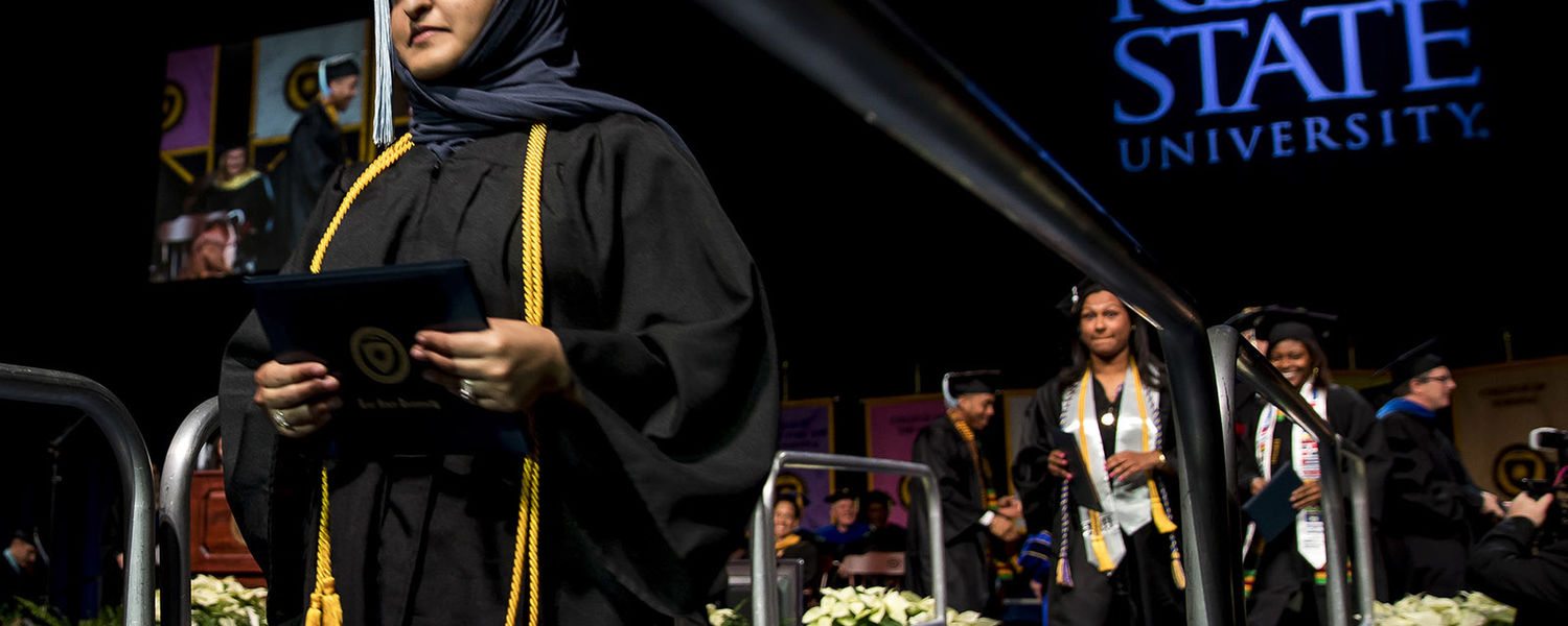 New Kent State graduates walk down the ramp during Commencement.