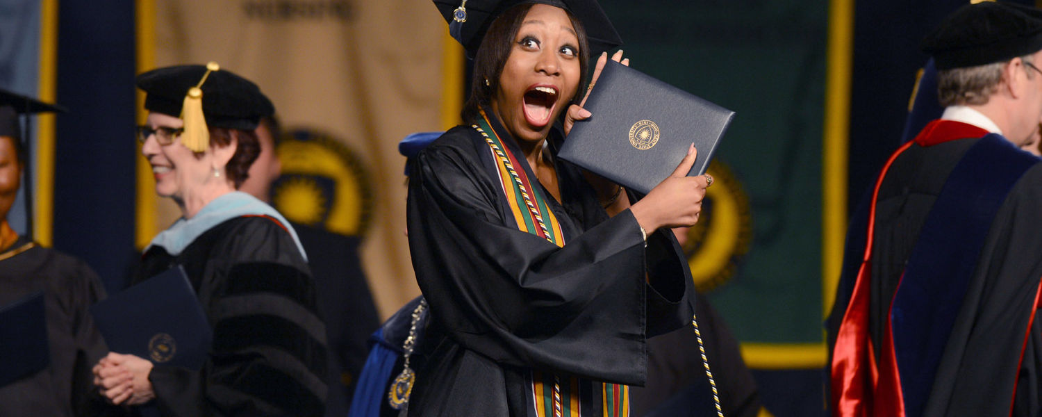 A Kent State graduate shows off her new degree.