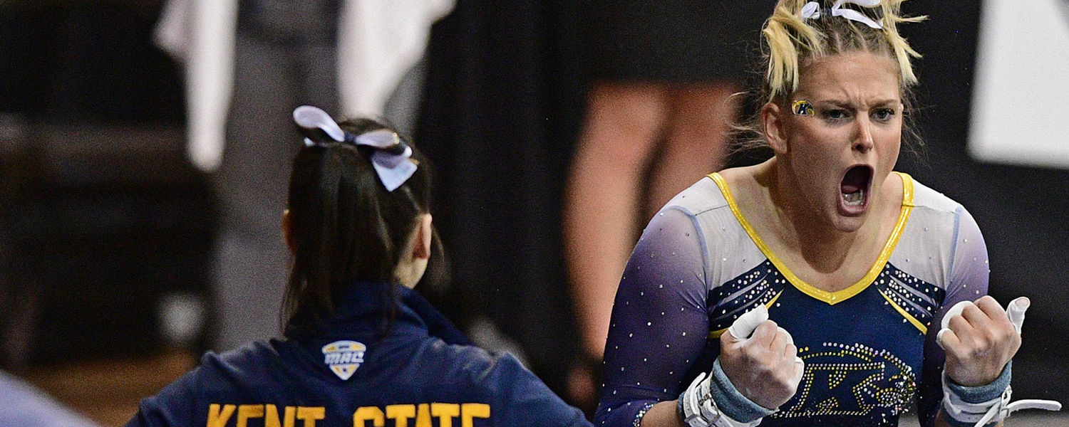 Kent State's Rachel Stypinski celebrates after sticking the landing of her uneven bars performance. (Photo credit: David Dermer)