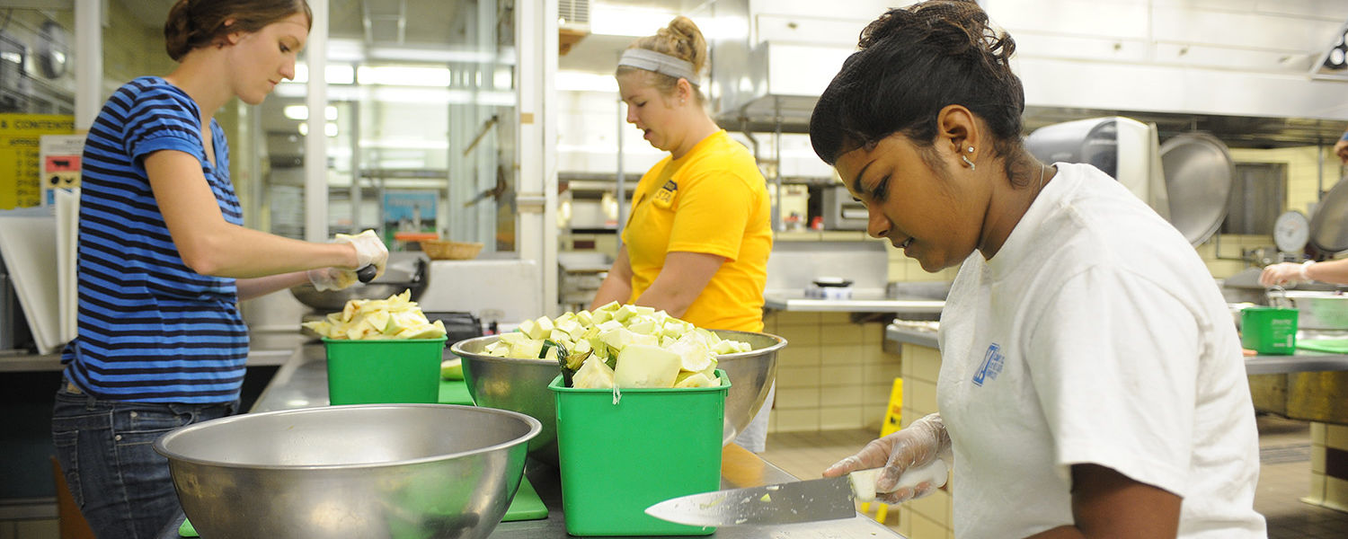 Kent State students volunteer at the Campus Kitchen at Kent State by preparing food in Beall Hall.