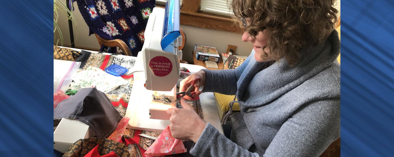 School of Fashion Assistant Professor, Rachel LoMonaco-Benzing, Ph.D., sews masks in her home studio.