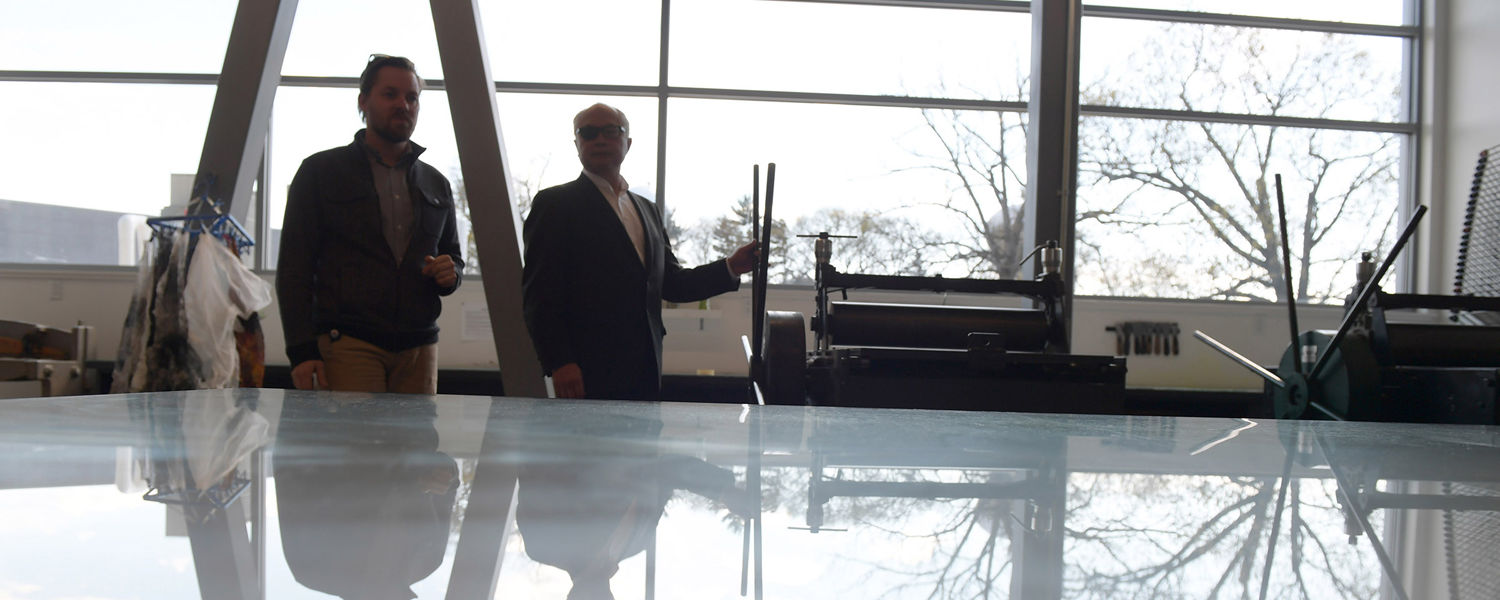 Two people tour the printmaking space in Kent State's new Center for the Visual Arts.